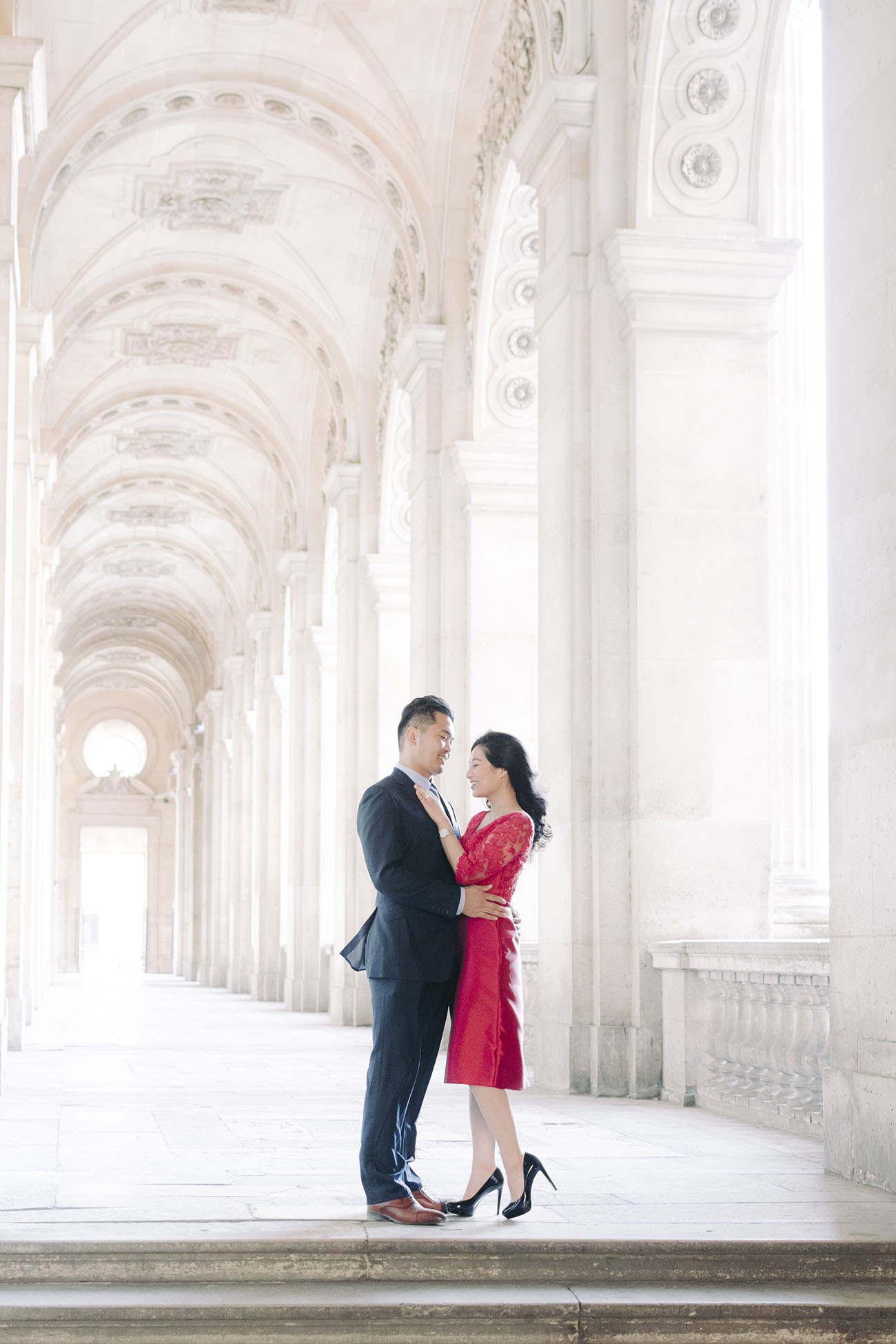 she put on her most beautiful red dress for photo pre wedding paris